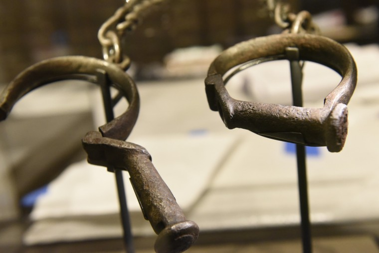 Wrought-iron shackles made before 1863 and used to restrain enslaved people aboard ships crossing the Atlantic to the Americas are seen on display at the National Museum of African American History and Culture.  The museum, located on the National Mall, opens September 24. It has 34,000 artifacts housed in 400,000-square-foot structure.  Sixty percent of the building is below ground. (Kim Hairston/Baltimore Sun)
