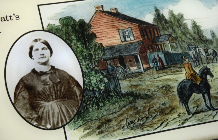 Mary Surratt, at left on an educational panel outside the Surratt House Museum, was a Confederate sympathizer who was hung for her aid to John Wilkes Booth after his assassination of President Abraham Lincoln. The Surratt Tavern, pictured in the illustration, also operated the Post Office, which gave the area its name, Surrattsville. The notoriety led to the name change from Surrattsville to Robeysville, and in 1879, the area was renamed Clinton. (Amy Davis/Baltimore Sun)