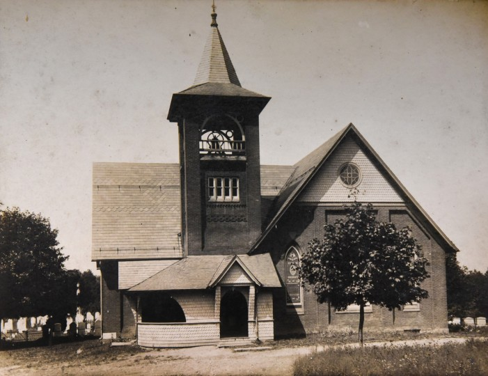 This undated early 20th c. photograph, on display at the West LIberty United Methodist Church, shows the building some time after it was built in 1898. It replaced the Meredith Meeting House of 1819. The earliest Methodist worshippers in the late 18th century in this community were served by circuit riders.  The area, once called Trump, is now known as West Liberty, a neighborhood within the unincorporated community of White Hall in northern Baltimore County.  (Amy Davis/Baltimore Sun)