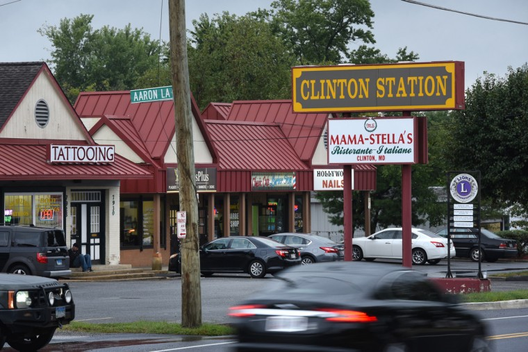 Traffic whizzes by the stores at Clinton Station on Old Branch Road, a heavily traveled route in this bedroom community for many workers who commute to Andrews Air Force Base or Washington, D.C.  (Amy Davis/Baltimore Sun)