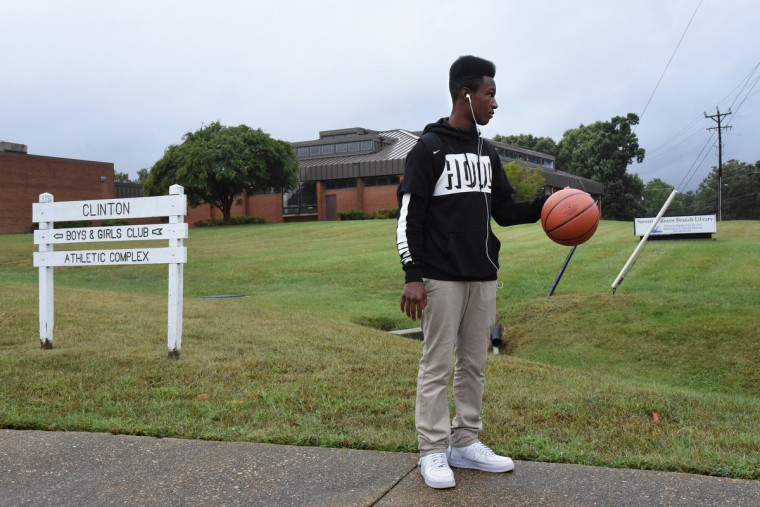 Amman Aryeetey, 15, bounces a basketball as he waits for a ride home to Accoceek. His family has roots in Clinton because his grandfather worked at Andrews Air Force Base, and his grandparents still live in Clinton. (Amy Davis/Baltimore Sun)