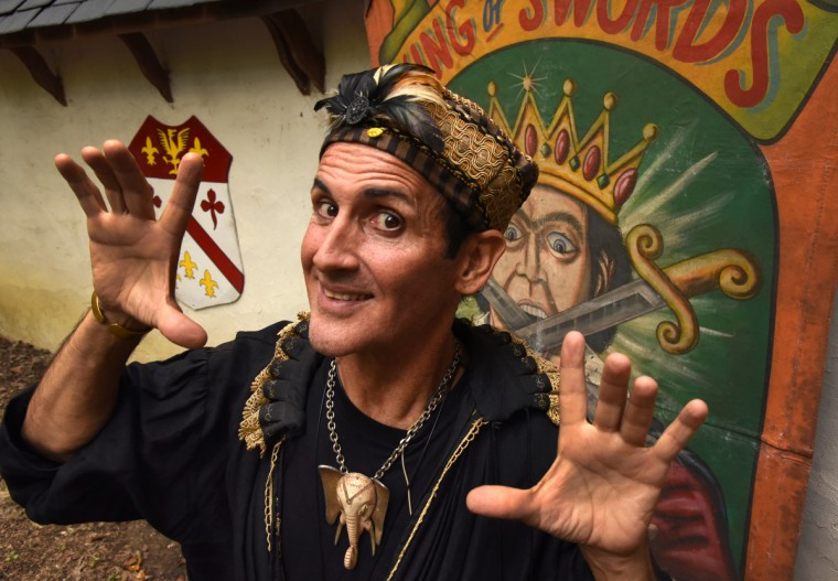 "Johnny Fox, who is in his 38th season performing at the Maryland Renaissance Festival, is known as the ""sword swallower extraordinaire,"" but he also does other magic tricks with comic flair. (Amy Davis/Baltimore Sun)"