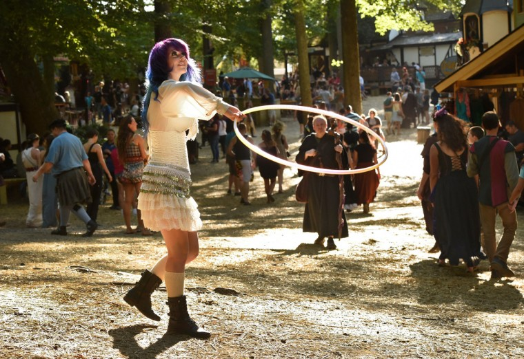 Candy Mozeliak, who works at the John Sosnowsky art gallery, takes a break to play with a hoop at the Maryland Renaissance Festival.  (Amy Davis/Baltimore Sun)