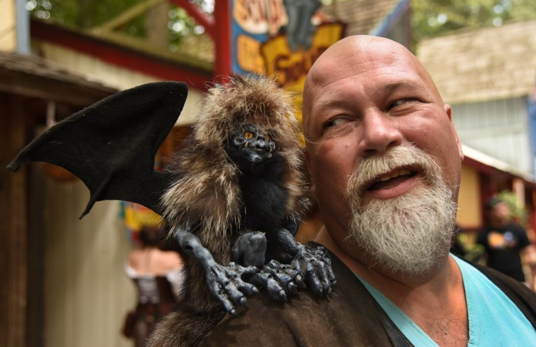 Brent Ferrell, of the Midsummer Knights Dream craft shop at the Renaissance Festival, with one of the animated fantasy pets he creates, a little winged demon called Nocturnus. (Amy Davis/Baltimore Sun)