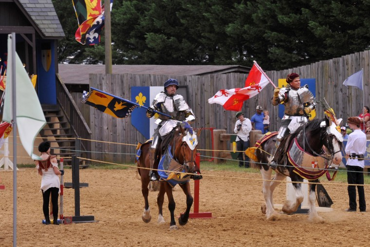 The Joust Arena at the Maryland Renaissance Festival seats 5,000 people. Flag-bearing riders begin the Free Lancer joust. (Amy Davis/Baltimore Sun)