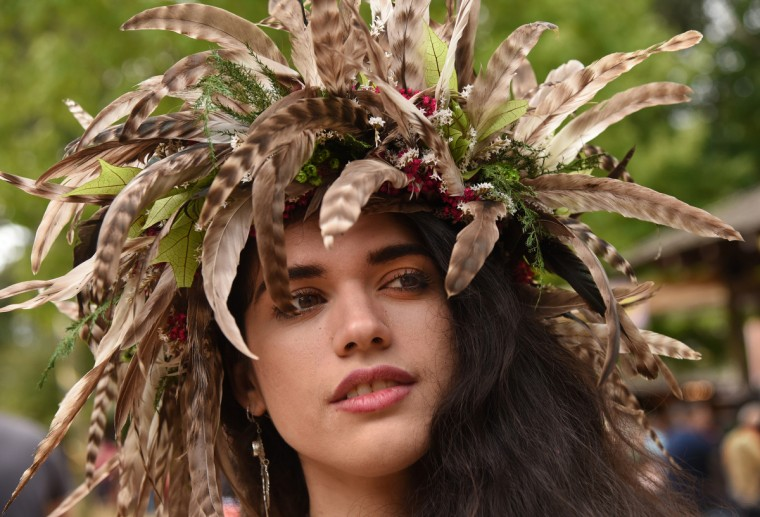 Claire Martinez models one of the more elaborate flower garlands she sells at the Maryland Renaissance Festival. (Amy Davis/Baltimore Sun)
