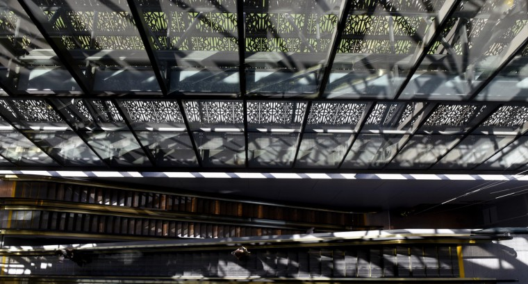 Light filters through the cast aluminum panels of the Smithsonian National Museum of African American History and Culture (NMAAHC).  (Kim Hairston/Baltimore Sun)