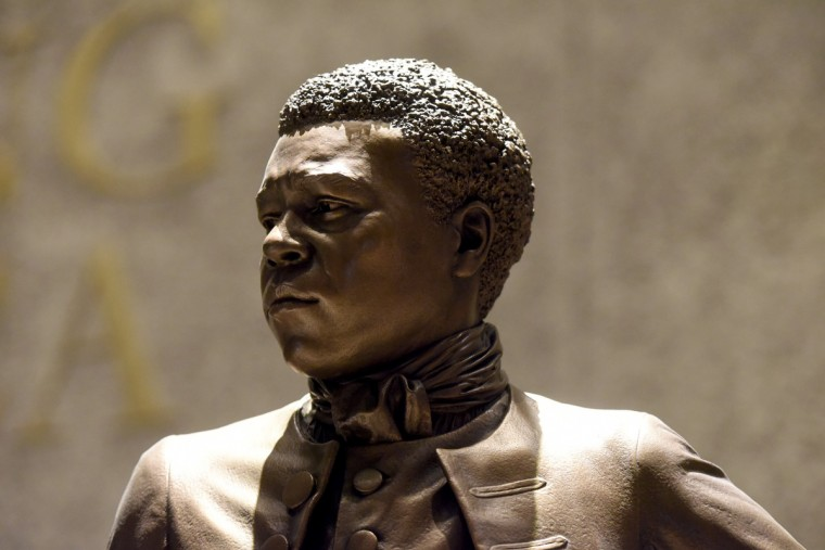 "A sculpture of Benjamin Banneker, a mathematician, astronomer, inventor. Banneker stands with images of Thomas Jefferson, Phyllis Wheatley, Elizabeth ""Mumbet"" Freeman and Toussaint L'Ouverture.   (Kim Hairston/Baltimore Sun)"