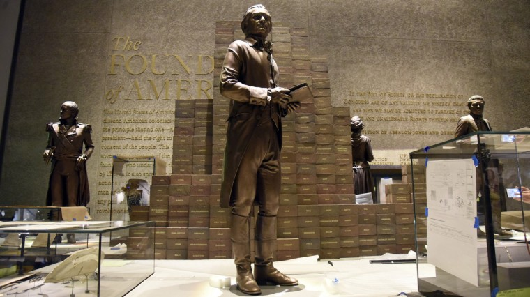 Behind a sculpture of Thomas Jefferson are bricks with the names of 609 people Jefferson owned during his lifetime. (Kim Hairston/Baltimore Sun)