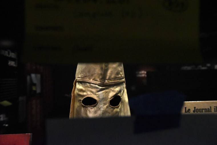 A satin Ku Klux Klan hood is seen at the National Museum of African American History and Culture. (Kim Hairston/Baltimore Sun)