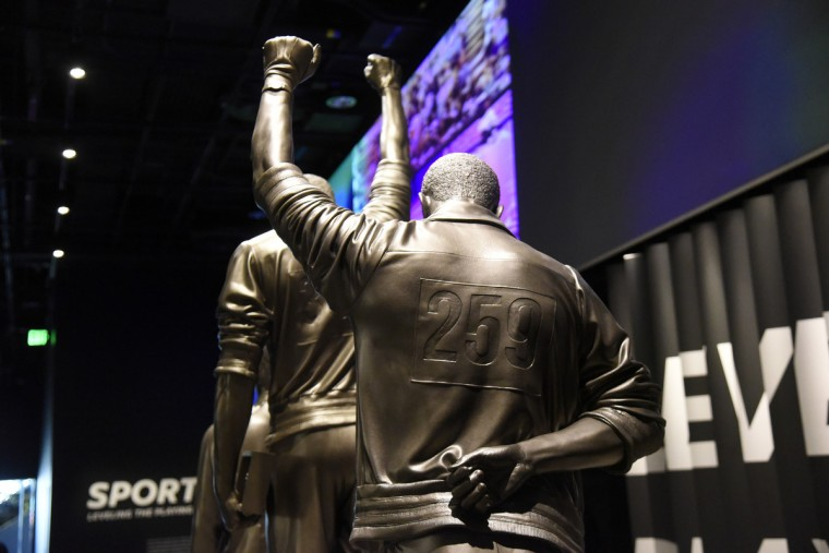 Sculpture of #307 Tommie Smith and #259 John Carlos October 16, 1968 at the Olympics in Mexico City. The athletes raised gloved fists on the podium during the National Anthem to  protest racial discrimination in the United States.  (Kim Hairston/Baltimore Sun)