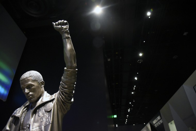 A sculpture of John Carlos, who along with Tommie Smith,  raised gloved fists on the podium during the National Anthem at the Olympics in Mexico City on October 16, 1968. The athletes were protesting racial discrimination in the United States.   (Kim Hairston/Baltimore Sun)
