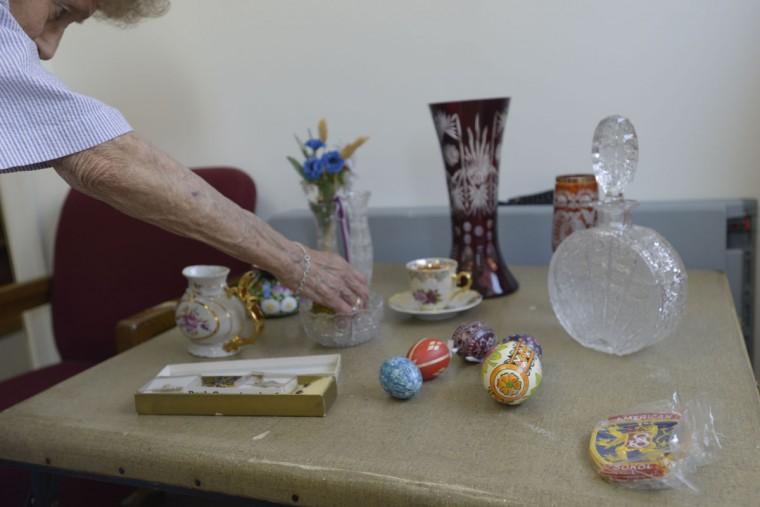 Ann Huber displays a variety of Czech handicrafts. (Christina Tkacik/Baltimore Sun)