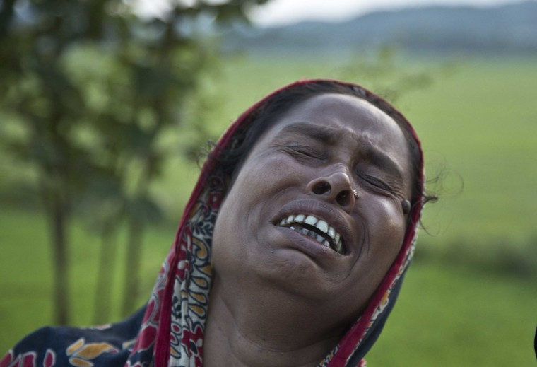 Mazida Beghum, 40, mother of Anjuma Beghum, 18, who was killed in police firing cries at Bandardubi village on the periphery of the Kaziranga National Park, northeastern Assam state, India, Monday, Sept. 19, 2016. Authorities ordered the demolition of around 300 houses in three villages to evict people living on the periphery of the rhino sanctuary to stop rampant poaching of the rare animal, a top police official said. Two people were killed and several others were injured Monday when villagers clashed with police while protesting the demolition of their homes. (AP Photo/Anupam Nath)