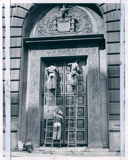 Workmen polishing the Federal Reserve Bank doors in 1963. (Malashuk/Baltimore Sun)