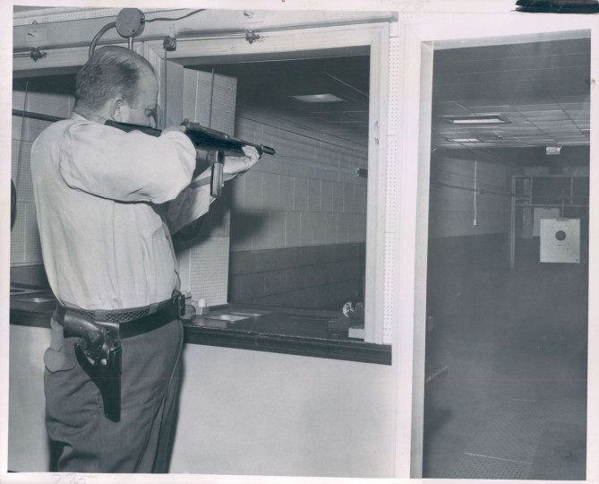 A 1959 photo shows a guard taking target practice in the basement of the Federal Reserve Bank in Baltimore. (Albert D. Cochran/Baltimore Sun)