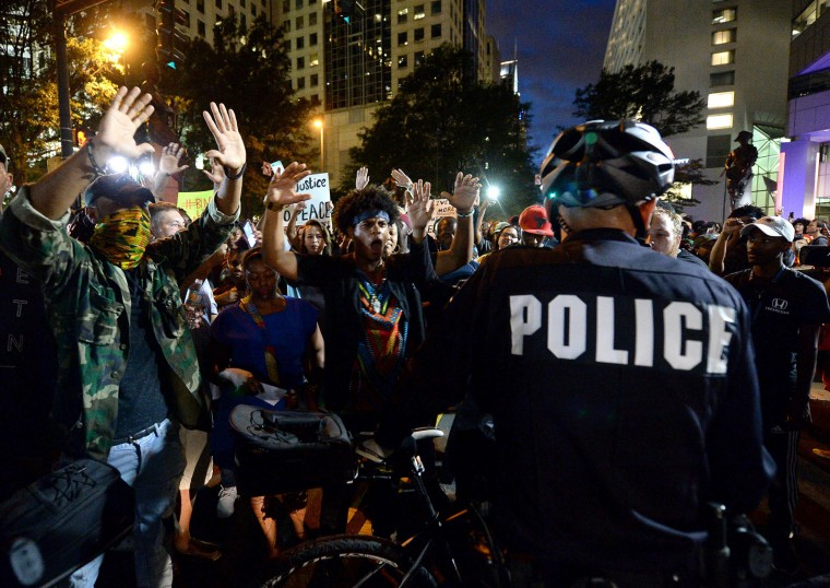 Protestors confront bicycle officers along Trade Street in Charlotte, N.C., on Wednesday, Sept. 21, 2016. The protestors were rallying against the fatal shooting of Keith Lamont Scott by police on Tuesday evening in the University City area. (Jeff Siner/The Charlotte Observer/TNS)