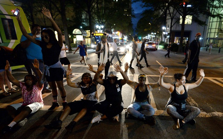 Protestors block an intersection at Trade and Tryon Streets in Charlotte, N.C., on Wednesday, Sept. 21, 2016. The protestors were rallying against the fatal shooting of Keith Lamont Scott by police on Tuesday evening in the University City area. (Jeff Siner/The Charlotte Observer/TNS)