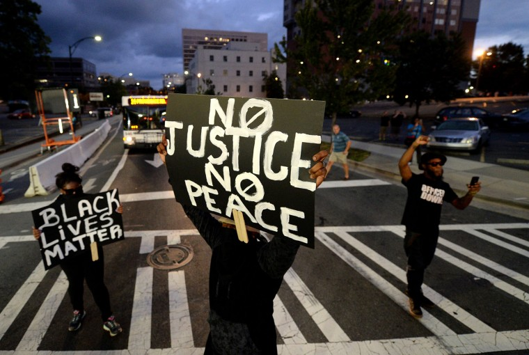 Protestors block an intersection near the Transit Center as they march uptown in Charlotte, N.C., on Wednesday, Sept. 21, 2016. The protestors were rallying against the fatal shooting of Keith Lamont Scott by police on Tuesday evening in the University City area. (Jeff Siner/The Charlotte Observer/TNS)
