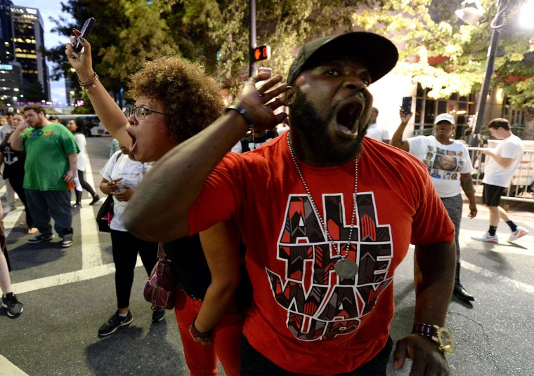 Protestors chant and listen for others' response as they march to the Epicentre in Charlotte, N.C., on Wednesday, Sept. 21, 2016. The protestors were rallying against the fatal shooting of Keith Lamont Scott by police on Tuesday evening in the University City area. (Jeff Siner/The Charlotte Observer/TNS)