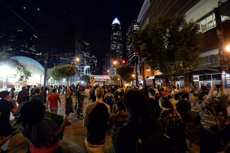 Protestors march up Trade Street in Charlotte, N.C., on Wednesday, Sept. 21, 2016. The protestors were rallying against the fatal shooting of Keith Lamont Scott by police on Tuesday evening in the University City area. (Jeff Siner/The Charlotte Observer/TNS)