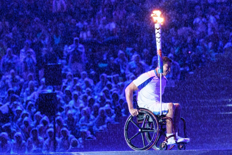 Brazilian swimmer Clodoaldo Silva holds the Paralympic torch to light the Paralympic cauldron during the opening ceremony of the Rio 2016 Paralympic Games at the Maracana stadium in Rio de Janeiro on September 7, 2016. (YASUYOSHI CHIBA/AFP/Getty Images)