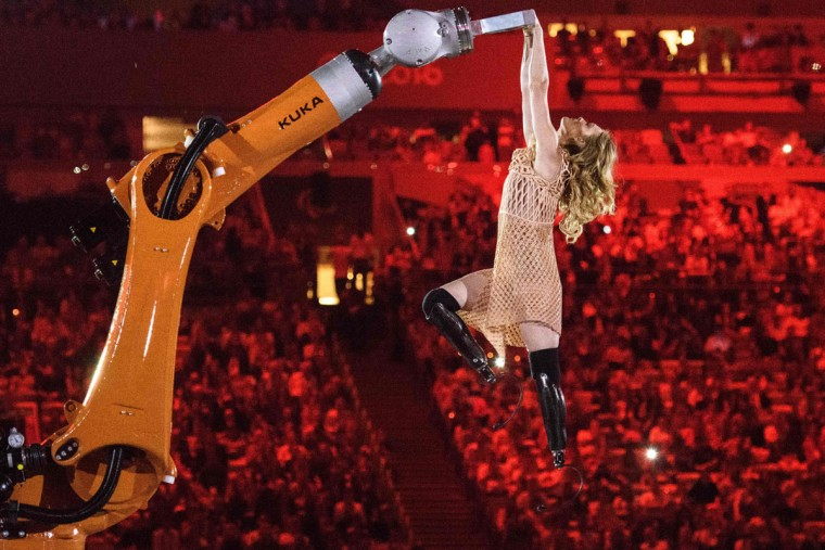 American Paralympic snowboarder Amy Purdy dances with a robot during the opening ceremony of the Rio 2016 Paralympic Games at the Maracana stadium in Rio de Janeiro on September 7, 2016. (YASUYOSHI CHIBA/AFP/Getty Images)