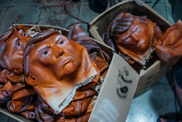 SHENZHEN, CHINA - OCTOBER 18: Masks of Donald Trump are seen in boxes at the Shenzhen Lanbingcai Latex Crafts Factory on October 18, 2016 in Shenzhen, China. Shenzhen Lanbingcai Latex Crafts Factory, located in the industrial area of Shenzhen with 20 to 30 employees, produces all sort of Halloween and party costumes and masks. It runs a small scale production of Donald Trump masks for local distribution within mainland China costing from 30 Renminbi onwards as the third Presidential Debate 2016 between Donald Trump and Hillary Clinton happens on Thursday. Chinese media have derided the election as a risible variety show in which the candidates' spectacular personal failings have taken precedence over the business of governance. (Photo by Anthony Kwan/Getty Images)