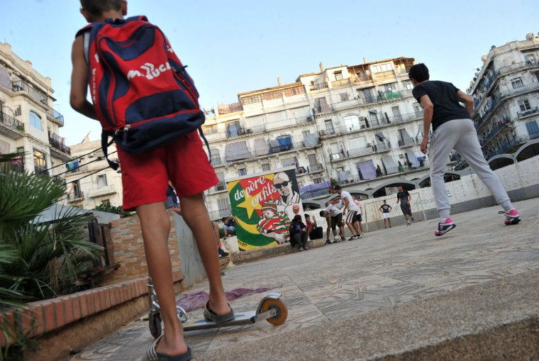 Algerians play football in the street in the Bab el-Oued neighborhood, which is historically known to be predominantly supporting Mouloudia Club Alger (MCA) football team in Algiers on October 11, 2016, two days ahead of the 100th derby match against their rival Union Sportive Medina d'Alger (USMA). (AFP PHOTO / Ryad Kramdi)