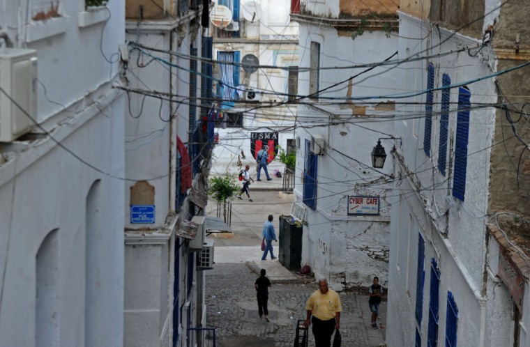 "A general view shows the Soustara neighborhood in the old part of Algiers known as the ""Casbah"", which is historically known to be predominantly supporting the Union Sportive Medina d'Alger (USMA) football club, on October 11, 2016, two days ahead of the 100th derby match against their rival Mouloudia Club d'Alger (MCA). (AFP PHOTO / Ryad Kramdi)"