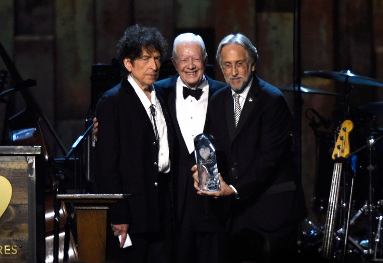 FILE -  (L-R) Honoree Bob Dylan, former U.S. President Jimmy Carter and National Academy of Recording Arts and Sciences President Neil Portnow appear onstage at the 25th anniversary MusiCares 2015 Person Of The Year Gala honoring Bob Dylan at the Los Angeles Convention Center on February 6, 2015 in Los Angeles, California. The annual benefit raises critical funds for MusiCares' Emergency Financial Assistance and Addiction Recovery programs.  (Photo by Frazer Harrison/Getty Images)
