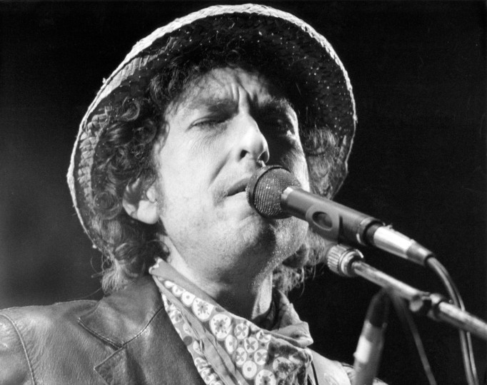 FILE - This file photo taken on June 3, 1984 shows US singer Bob Dylan performing during a concert at the Olympic stadium in Munich, southern Germany. US songwriter Bob Dylan won the Nobel Literature Prize on October 13, 2016, the first songwriter to win the prestigious award and an announcement that surprised prize watchers. (Istvan Bajzat/AFP/Getty Images)