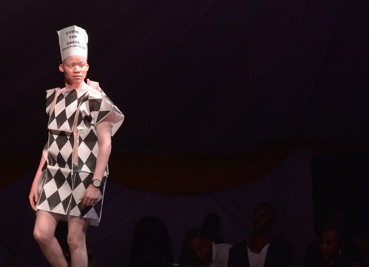 A contestant walks down the catwalk in her own creation at a pageant hosted by the Albinism Society of Kenya in Nairobi on October 21, 2016. In many parts of Africa albinos are stigmatized or hunted for their body parts, but for one night in Kenya those with the condition took to the catwalk to show off their unique beauty. Billed by organizers as the first pageant of its kind, young albino men and women competed for the title of Miss and Mr Albinism Kenya. (AFP PHOTO / TONY KARUMBA)