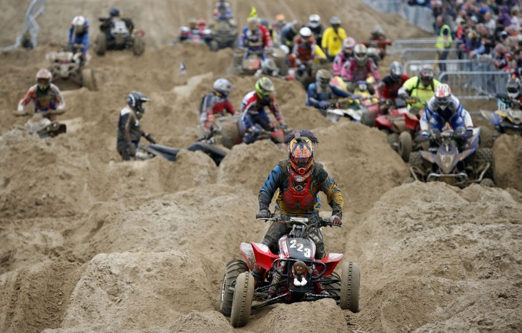 A quad rider negogiates the bumps during the Adult Quad and Sidecar race duringthe 2016 HydroGarden Weston Beach Race in Weston-super-Mare, south west England, on October 8, 2016. Beach racing is an offshoot of enduro and motocross racing. Riders on solo motorcycles and quad bikes compete on a course marked out on a beach, with man-made jumps and sand dunes being constructed to make the course tougher. (ADRIAN DENNIS/AFP/Getty Images)