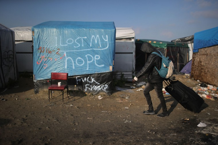 A migrant leaves the notorious 'Jungle' camp as the authorities begin the task of demolishing the site on October 25, 2016 in Calais, France. Many migrants have left by coach to be reloctated at centres across France as Police and officials in France begin to clear the 'Jungle' migrant camp in Calais. Some 7,000 people are estimated to be living in the camp in squalid conditions. (Photo by Christopher Furlong/Getty Images)