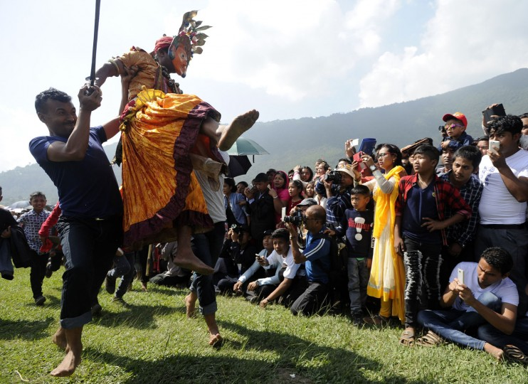 A Nepalese Hindu devotee, dressed as a deity, (2L) participates in festivities in celebration of the Shikali Jatra festival at the Shikali Temple in the village of Khokana, on the outskirts of Kathmandu on October 7, 2016. Local villagers, who normally do not celebrate the country's most famous festival of Dashain, celebrate the Shikali Jatra each year. (Prakash Mathema/AFP/Getty Images)