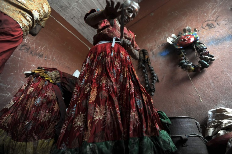 A Nepalese Hindu devotee dresses as a deity in preparation for celebration of the Shikali Jatra festival at the Shikali Temple in the village of Khokana, on the outskirts of Kathmandu on October 7, 2016. Local villagers, who normally do not celebrate the country's most famous festival of Dashain, celebrate the Shikali Jatra each year. (Prakash Mathema/AFP/Getty Images)