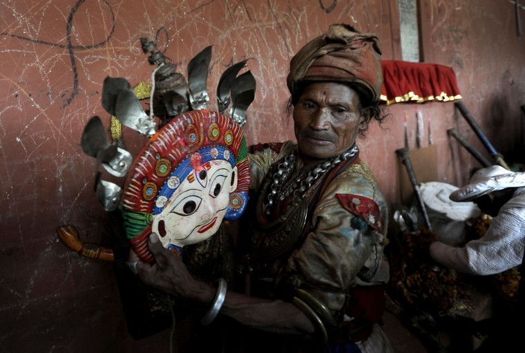 A Nepalese Hindu devotee dresses as a deity in preparation for the celebration of the Shikali Jatra festival at the Shikali Temple in the village of Khokana, on the outskirts of Kathmandu on October 7, 2016. Local villagers, who normally do not celebrate the country's most famous festival of Dashain, celebrate the Shikali Jatra each year. (Prakash Mathema/AFP/Getty Images)