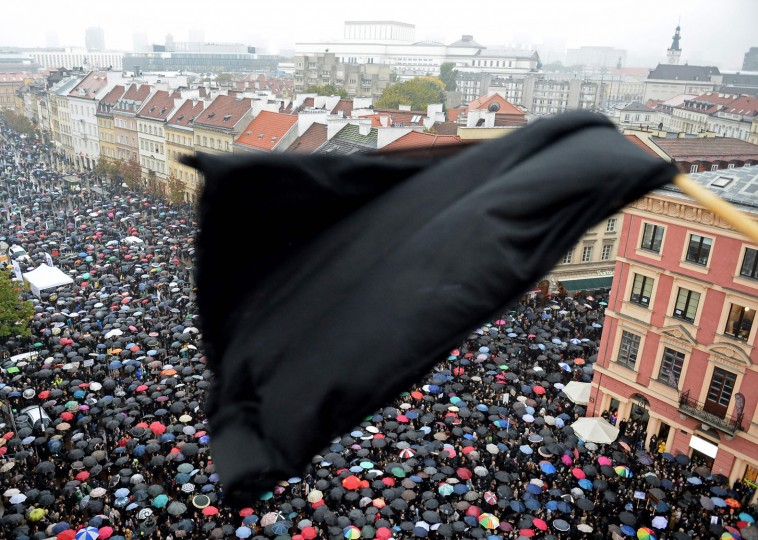 "A black flag is seen as people take part in a nationwide strike and demonstration to protest against a legislative proposal for a total ban of abortion on October 3, 2016 in Warsaw. Thousands of women dressed in black protested across Poland in the ""Women strike"" campaign against a proposed near-total abortion ban in the devoutly Catholic country where legislation is already among the most restrictive in Europe. (Janek Skarzynski/AFP/Getty Images)"
