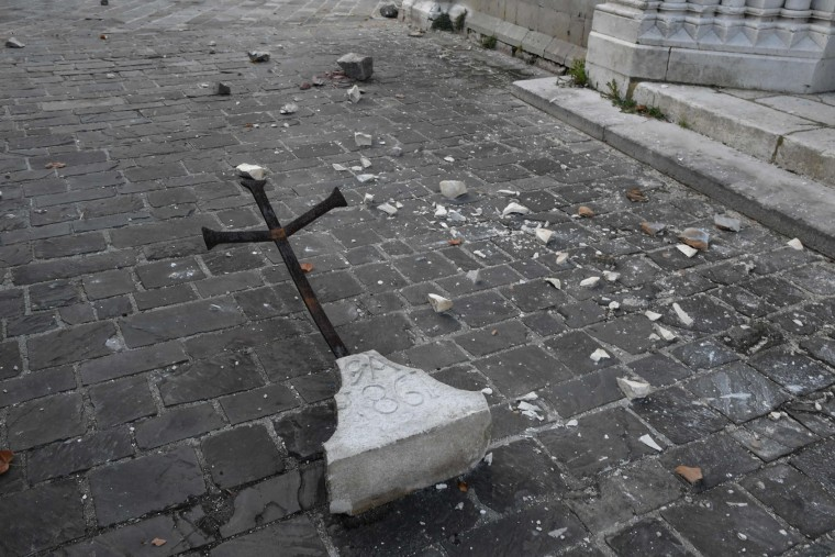 A cross fallen from a building due to earthquakes, lies on the ground, in the village of Visso, central Italy, on October 27, 2016. Twin earthquakes rocked central Italy on October 26, 2016 -- the second registering at a magnitude of 6.0 -- in the same region struck in August by a devastating tremor that killed nearly 300 people. The quakes were felt in the capital Rome, sending residents running out of their houses and into the streets. The second was felt as far away as Venice in the far north, and Naples, south of the capital. (Tiziana Fabi/AFP/Getty Images)