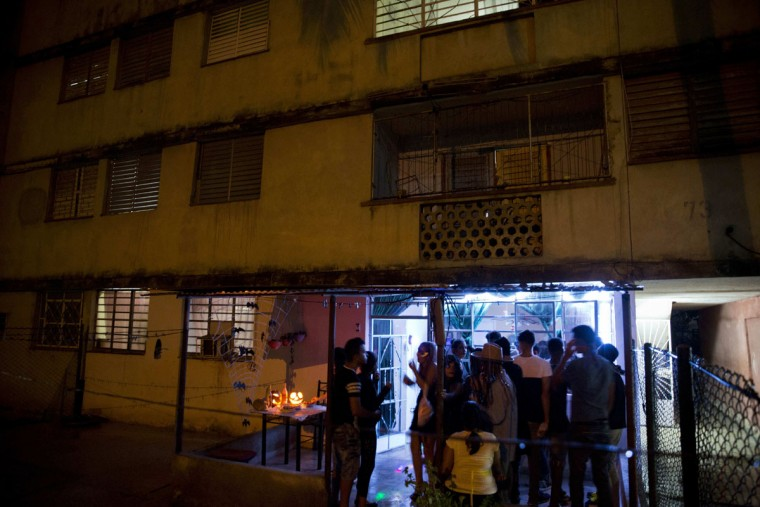 Youth gather for a Halloween party in Havana, Cuba, Friday, Oct. 28, 2016. The costume party was held in the ground-floor apartment of a Soviet-era housing project in Cuba's capital. (AP Photo/Ramon Espinosa)