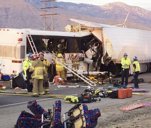 Emergency personnel work the scene where a tour bus crashed into the rear of a semi-truck on westbound Interstate 10, just north of the desert resort town of Palm Springs in Desert Hot Springs, Calif., Sunday, Oct. 23, 2016. Multiple deaths and injuries were reported. (Colin Atagi/The Desert Sun via AP)