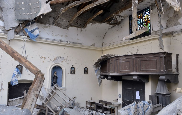 A view of a damaged church in the village of Visso, Italy, Thursday, Oct 27, 2016 after a 5.9 earthquake destroyed part of the town. Authorities scrambled to find housing Thursday for thousands of people displaced by a pair of strong earthquakes that struck the same region of central Italy hit by a deadly quake in August. (AP Photo/Sandro Perozzi)