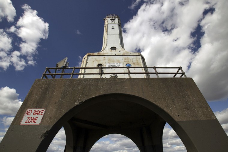 This photo taken Sept. 26, 2016 shows the light head on the Port Washington, Wis., breakwater. The city is in the process of acquiring it, with plans to raise and spend $1.5 million to restore. (AP Photo/Carrie Antlfinger)