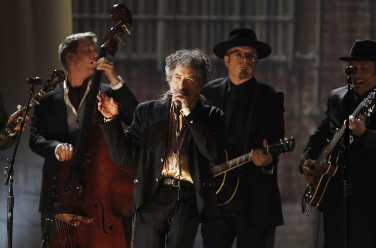 "FILE - In this Feb. 13, 2011, file photo, Bob Dylan, center, performs at the 53rd annual Grammy Awards in Los Angeles. Dylan won the 2016 Nobel Prize in literature on Thursday, Oct. 13, 2016, a stunning announcement that for the first time bestowed the prestigious award on a musician for ""having created new poetic expressions within the great American song tradition."" (AP Photo/Matt Sayles, File)"