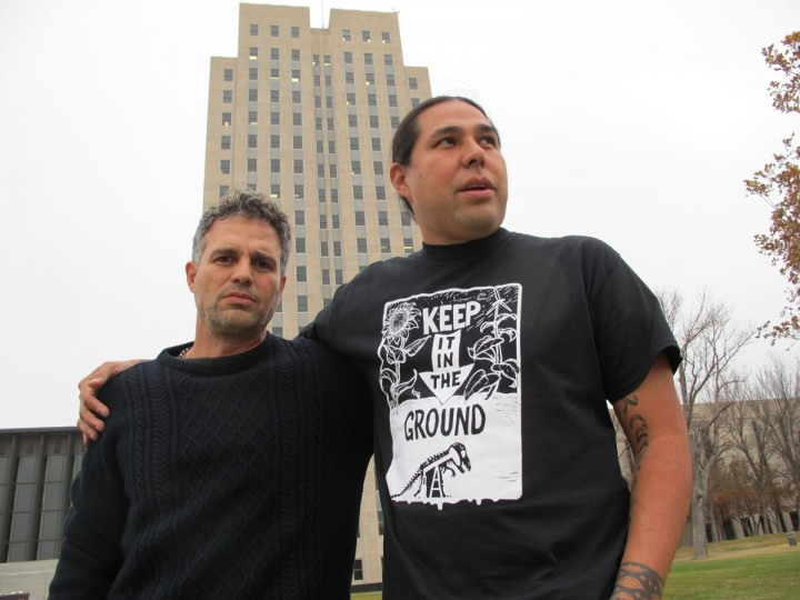 Actor-activist Mark Ruffalo, left, poses with Dallas Goldtooth, of the Indigenous Environmental Network, outside the state Capitol in Bismarck, N.D., Tuesday, Oct. 25, 2016. Ruffalo traveled to North Dakota to support the Standing Rock Sioux Tribe in its opposition to the Dakota Access oil pipeline. Ruffalo is co-founder of The Solutions Project, which promotes clean and renewable energy. (AP Photo/James MacPherson)