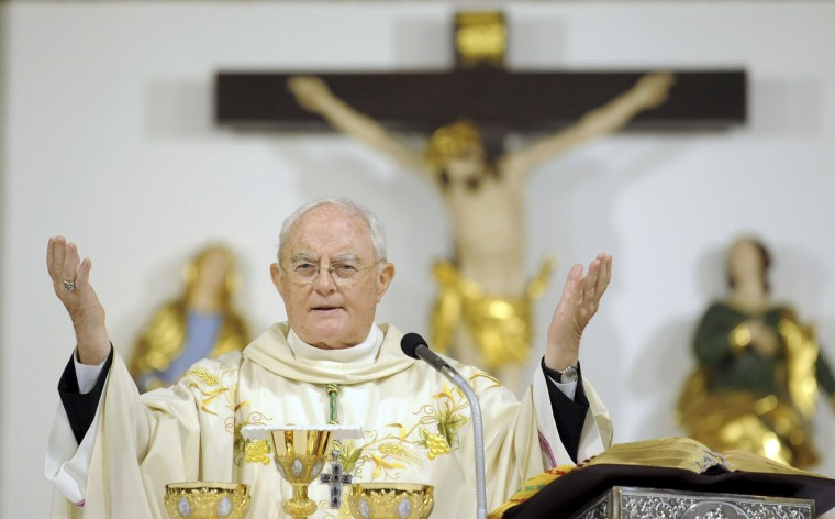 Archbishop Henryk Hoser celebrates a Mass at St. Florian's Cathedral supporting a legislative proposal for a total ban on abortion in Warsaw, Poland, Monday, Oct. 3, 2016. Similar Masses took place in many churches in opposition to a nationwide strike by Polish women on Monday protesting the proposal of a stricter anti-abortion law. (AP Photo/Alik Keplicz)