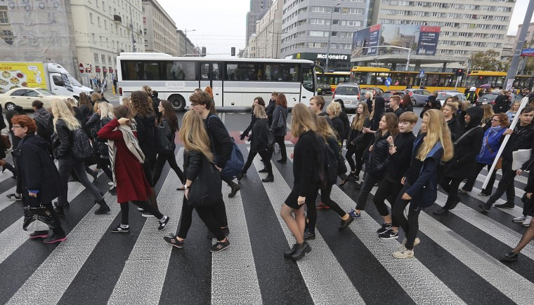 "Black-clad Polish women and some male supporters march during a nationwide strike and demonstration to protest a legislative proposal for a total ban on abortion in Warsaw, Poland, Monday, Oct. 3, 2016. Polish women are waging a nationwide strike to protest a legislative proposal for a total ban on abortion, with workers and students boycotting their jobs and classes and housewives refusing to do housework. Some businesses and restaurants are also closed on what is being called ""Black Monday,"" an expression of outrage against a proposal to further restrict an abortion law that is already one of the most limited in Europe. (AP Photo/Czarek Sokolowski)"