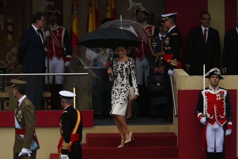 "Spain's Queen Letizia, centre, leaves the stage at the end of a military parade during a national holiday known as ""Dia de la Hispanidad"" or Hispanic Day, in Madrid, Spain, Wednesday, Oct. 12, 2016. Almost a year into Spain's political deadlock, the country is celebrating its National Day with a military parade of over 3,000 soldiers marching through Madrid and aircraft drawing trails of red and yellow smoke in the sky to represent the flag. (AP Photo/Francisco Seco)"