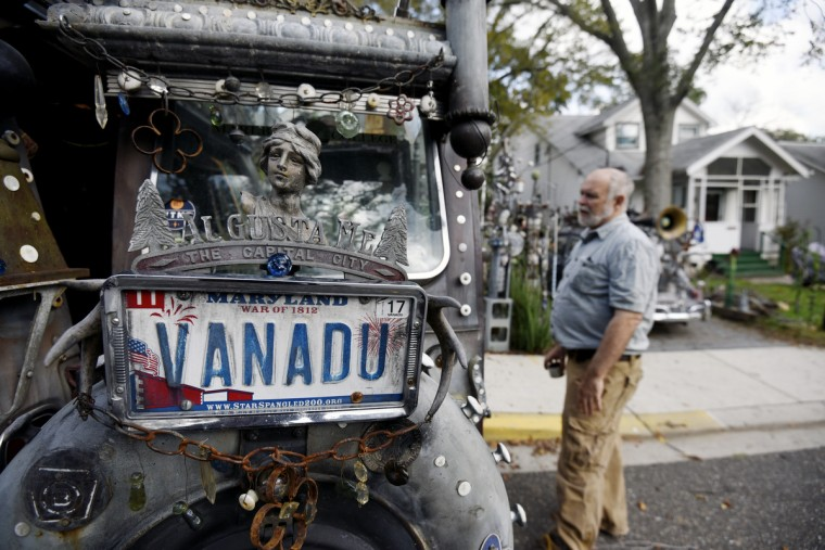 Vanadu, A. Clarke Bedford's Ford Econoline van, is parked outside his home. (Kim Hairston/Baltimore Sun)